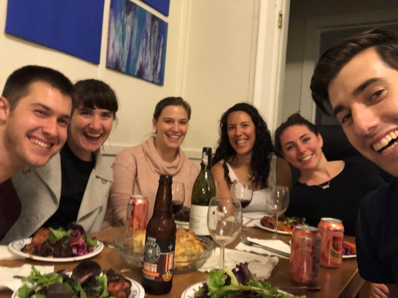 MBA students seated around a dinner table.