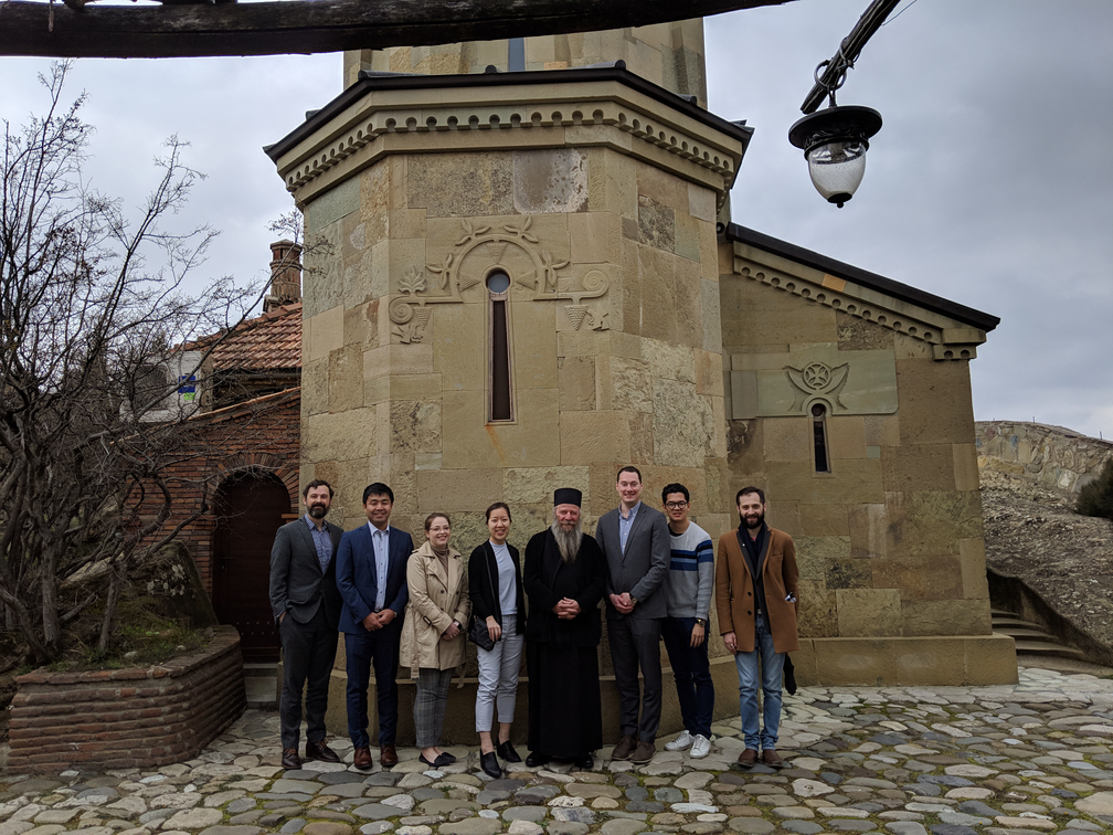 The team standing outside a church