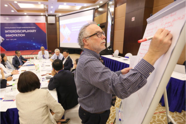 Gary Thompson with flipchart-Academic Consulting Project