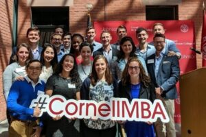 Park Fellows pose for a photo with a #CornellMBA sign