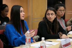 Female student speaks at roundtable.