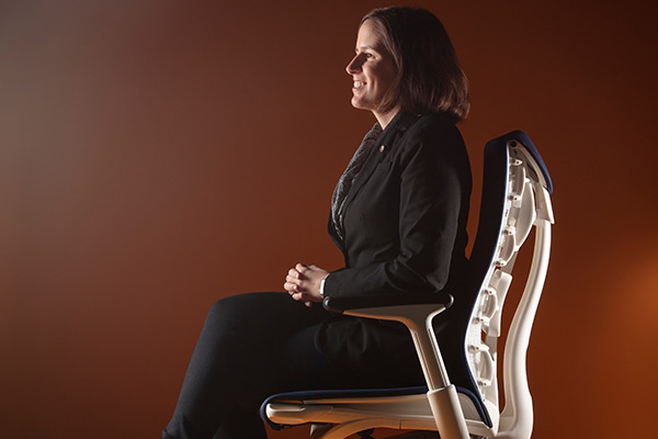 Christina Keller in profile, sitting in a Herman Miller chair