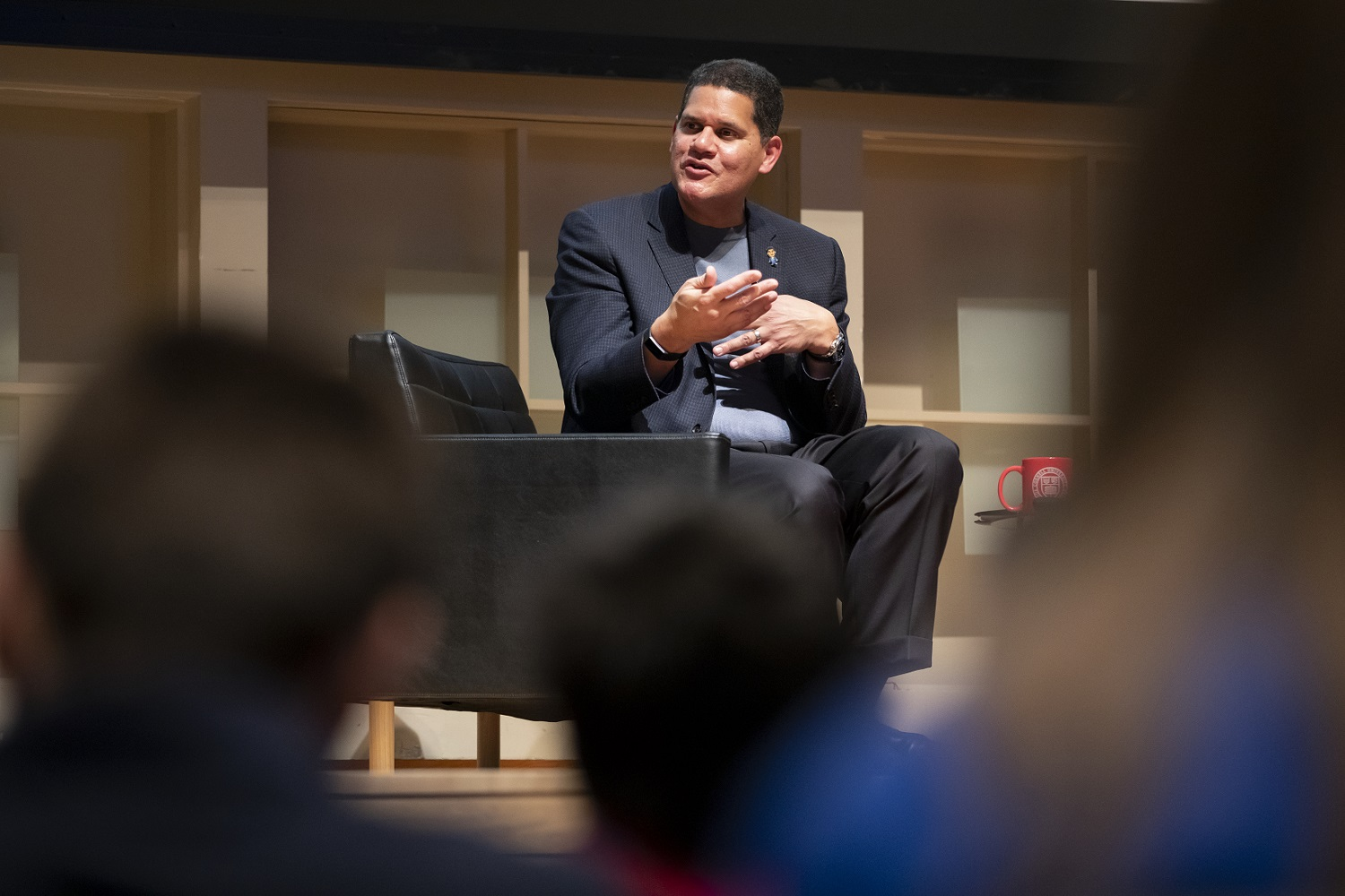 Reggie leads a discussion from on stage