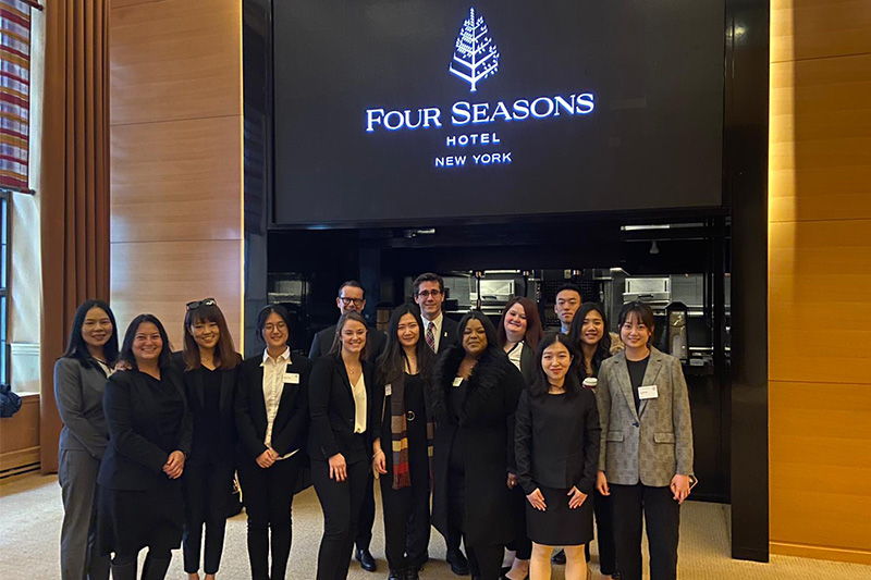 MMH students stand in front of Four Seasons Hotel entrance.