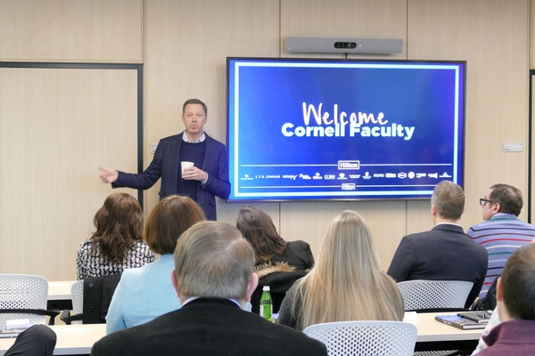 Kevin Jacobs '94, Hilton's EVP and CFO, welcomes the group to Hilton headquarters.
