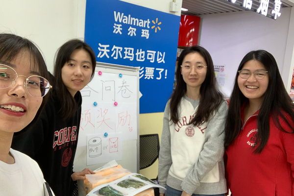 Students standing at a Walmart kiosk