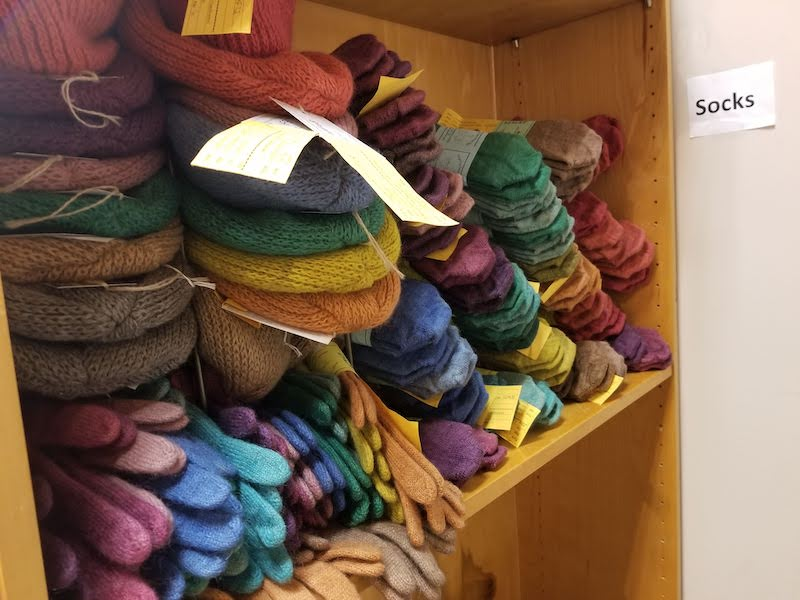 Lisa's handmade hats, gloves, and socks in a variety of colors