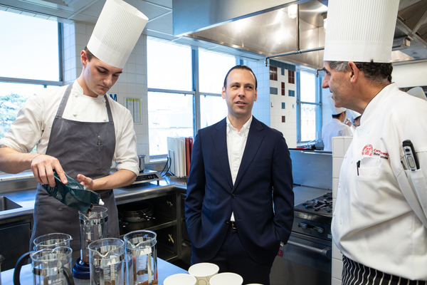 Jacob Chestnut talks with chef-instructor Anthony Vesco while SHA student Sean Koenig-Zanoff '21 prepares the coffee for a tasting session in The Business of Coffee.