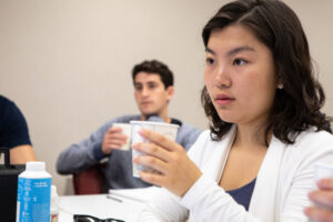 SHA student Wendy Yu '19 tastes a coffee sample in class.