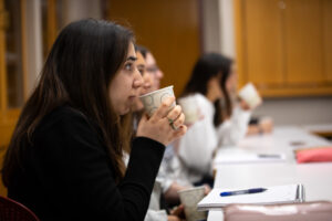 Eesha Chona '20 (Hum Ec) listens in class during a coffee tasting.