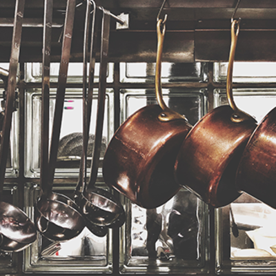 Hanging pans and ladles in a restaurant