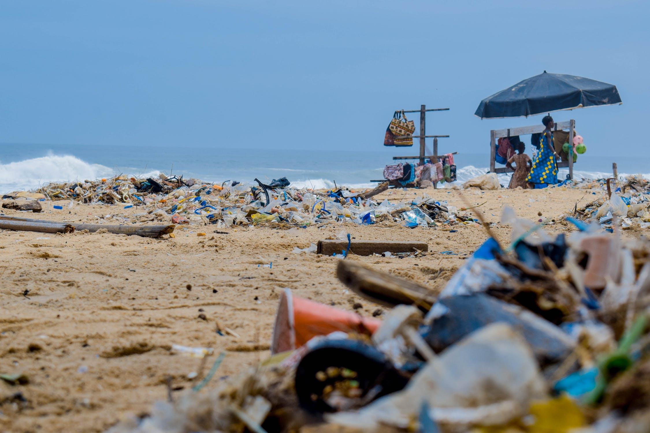 Plastic waste strewn about a beach