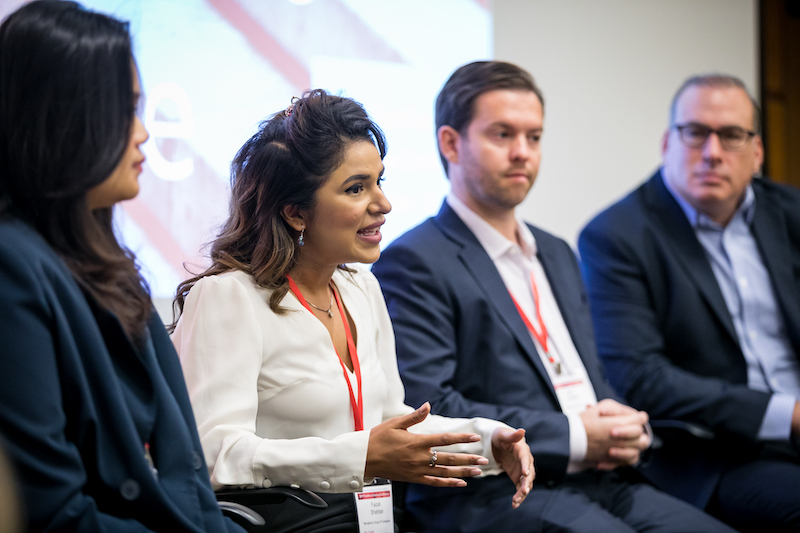 A panel of four people talking