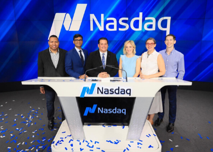 Sean and classmates ringing the bell at Nasdaq