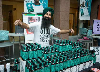 Prabhjot with bottled products at Battle of the Brands