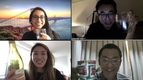 Four students on Zoom raise their glasses in celebration