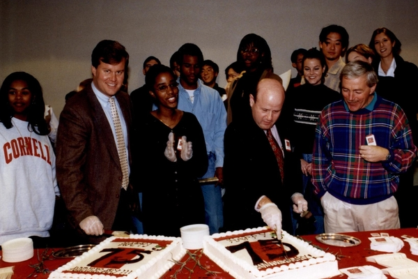 Phil Miller helps cut the cake at SHA's 75th anniversary celebration in 1998