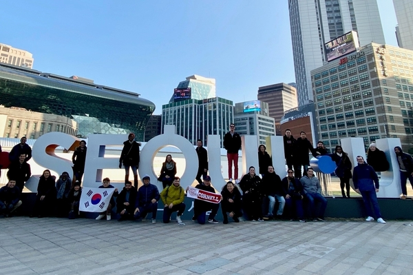 Trek participants pose at the Seoul sign in the capital city