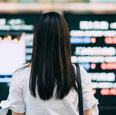 Woman looking at digital display on wall