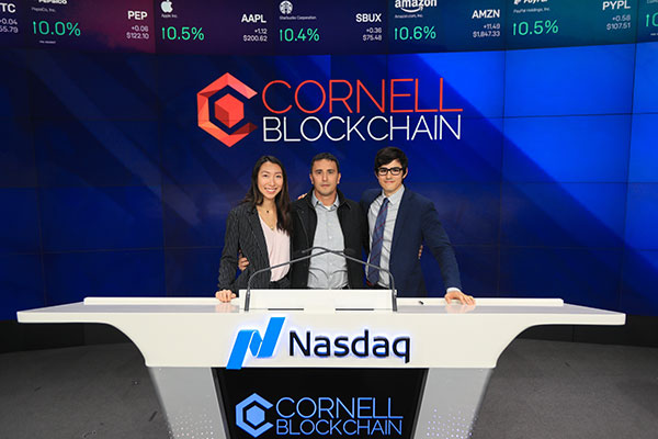 photos of (left to right) Lynette Ban '19, Emin Gün Sirer, associate professor of computer science, and Joe Ferrara '19 standing behind the podium at Nasdaq
