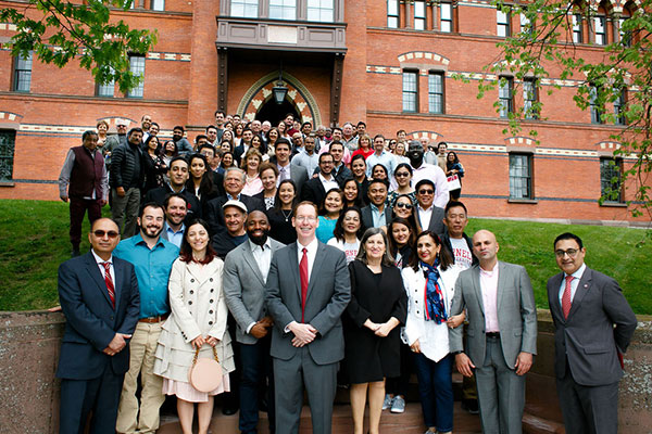 group photo of EMI Fellows with Johnson Dean Mark Nelson and Lourdes Casanova n the front and center
