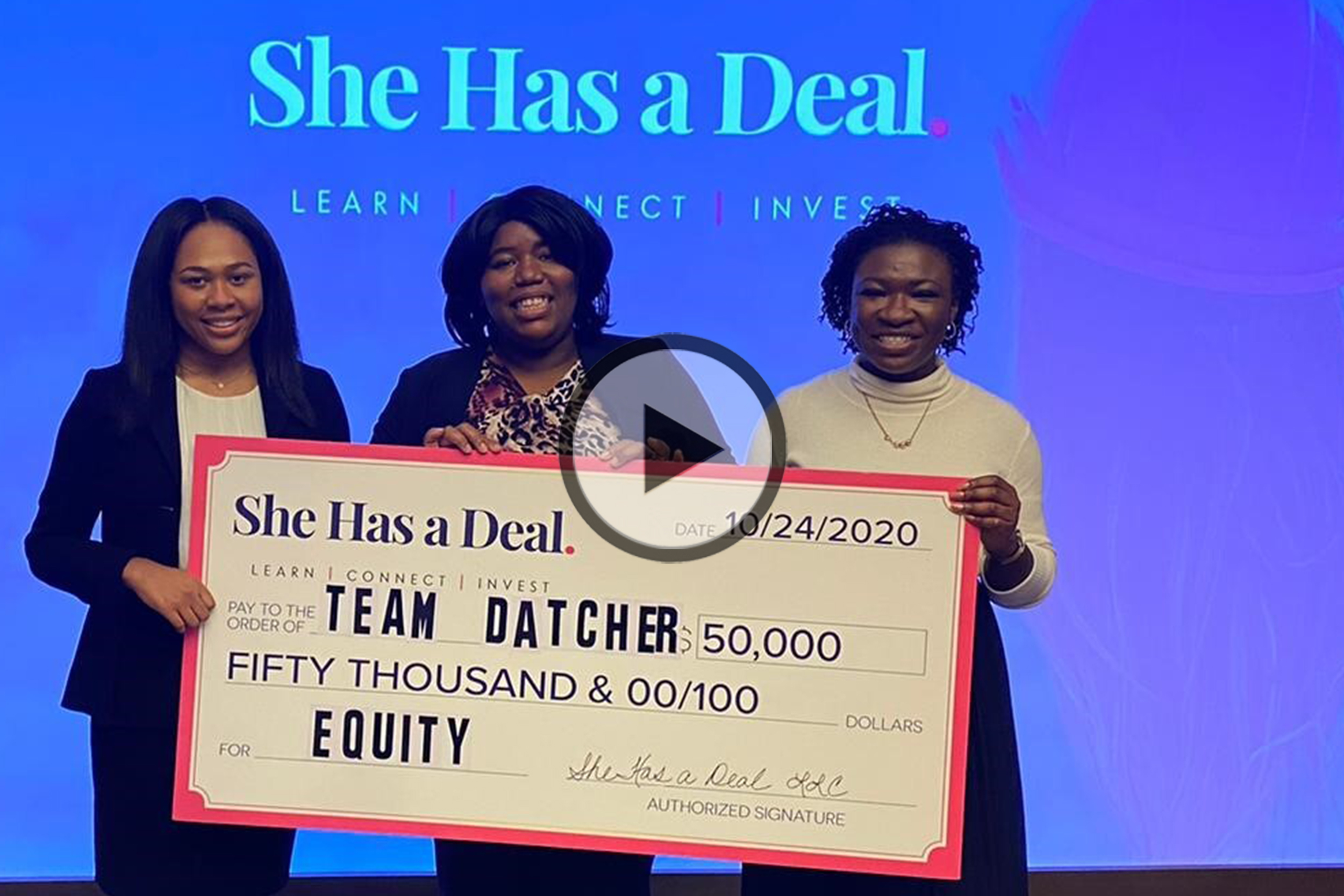 Kristen Collins, Lera Covington, and Joanne Angbazo holding their prize for winning She Has a Deal: a check for $50,000 in equity