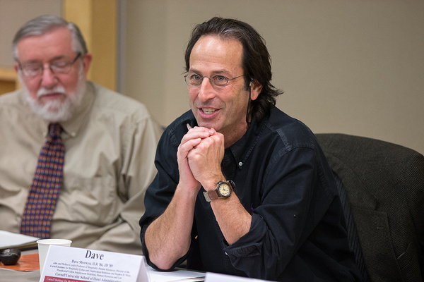 Photo of Professors Dave Sherwyn and Rick Hurd attend a pre-pandemic roundtableable