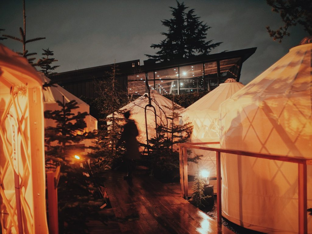 People dine in special yurts to proviode social distance during a pandemic.