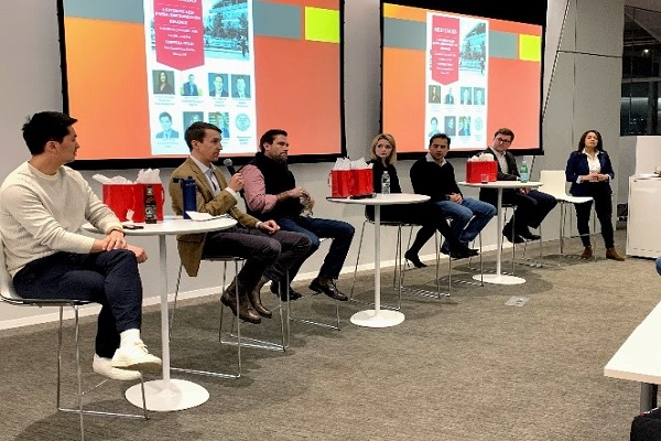 Image of seven EMBA Metro NY students on a conference panel.