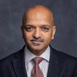 headshot of Manoj Thomas