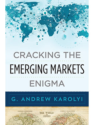 cover of a book by Andrew Karolyi, Cracking the Emerging Markets Enigma, includes a map of the world in the background
