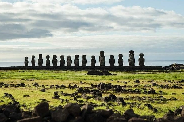 photo of Easter Island, ancient stone statues on a green landscape