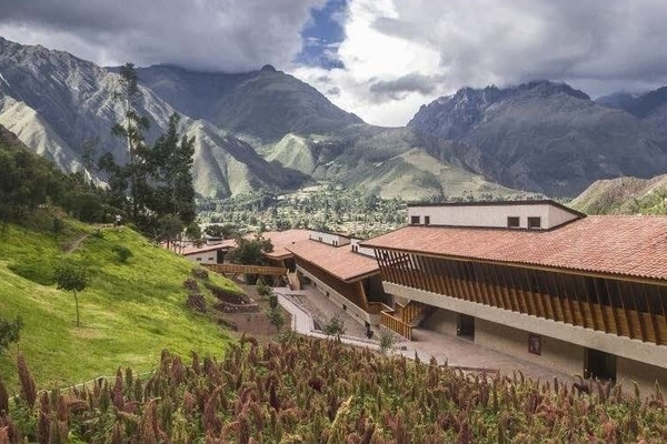 a hotel situated in a lush, Mountainous landscape