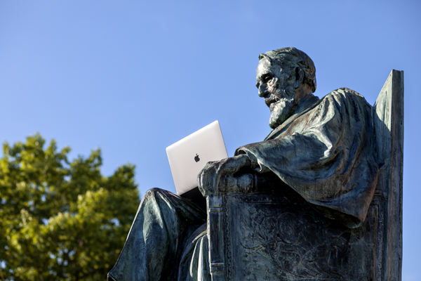 ad white statue with laptop