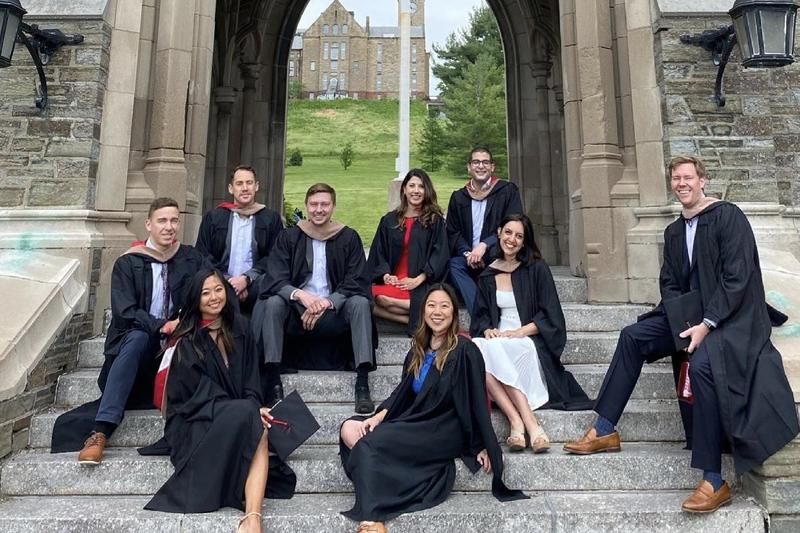 group of Johnson graduates posing on staircase