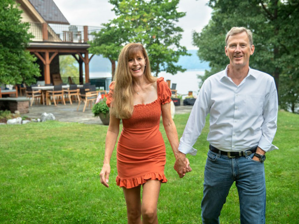 Peter and Stephanie Nolan hold hands and smile as they walk