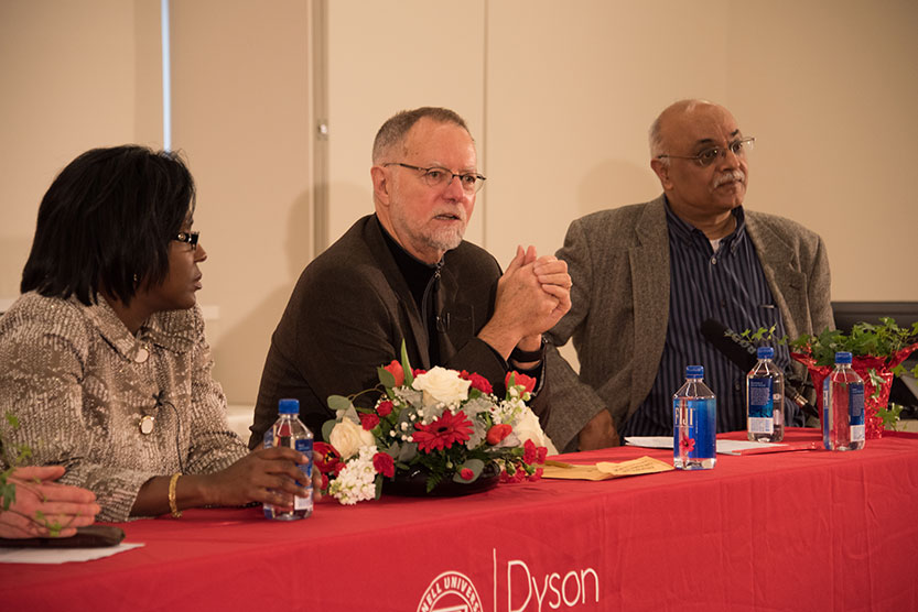 Left to right: Dean Lynn Wooten and Professors Robert H. Frank and Ravi Kanbur (moderator).