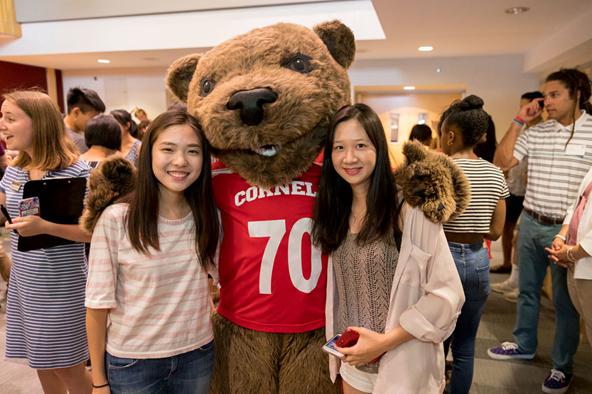 Students with Cornell bear mascot